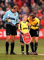 Lee Dixon and Alex Manninger with the Arsenal mascot. Liverpool 4:0 Arsenal, FA Carling Premiership, 23/12/2000. Credit Colorsport / Stuart MacFarlane.