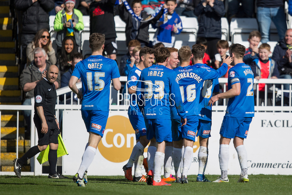 Hartlepool United players celebrate after Hartlepool United midfielder Michael Woods (14) scores their 2nd goal during  the Sky Bet League 2 match between Hartlepool United and York City at Victoria Park, Hartlepool, England on 16 April 2016. Photo by George Ledger.