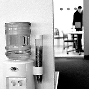 Black and white image of water dispenser in office