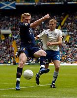 Photo: Jed Wee.<br />Scotland v Faroe Islands. European Championships 2008 Qualifying. 02/09/2006.<br /><br />Scotland's Garry O'Connor (L) keeps the ball away from Faroe Islands' Pauli Hansen.