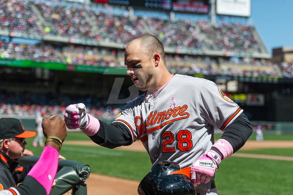 Steve Pearce #28 of the Baltimore Orioles is congratulated in the dugout after scoring against the Minnesota Twins on May 12, 2013 at Target Field in Minneapolis, Minnesota.  The Orioles defeated the Twins 6 to 0.  Photo: Ben Krause
