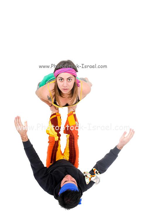 Balance - two acrobats balancing on each other. Man balances woman