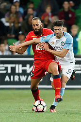 October 28, 2016 - Melbourne, Victoria, Australia - TAREK ELRICH (21) of Adelaide and JOSHUA ROSE (3) of Melbourne City fight for the ball in the round 4 match of the A-League between Melbourne City and Adelaide United at AAMI Park, Melbourne, Australia. Melbourne won 2-1 (Credit Image: © Sydney Low via ZUMA Wire)