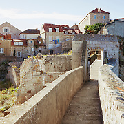 A walkway on the old city wall surrounding the homes in Dubrovnik, Croatia. <br />