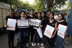 April 18, 2018 - Kolkata, West Bengal, India - Girl student hold poster during the rally demanding the protection of heritage building. Activist takes part in a rally to protest against demolition of Historic architecture in city on the occasion of World Heritage day. (Credit Image: © Saikat Paul/Pacific Press via ZUMA Wire)