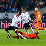 NLD/Amsterdam/20121114 - Vriendschappelijk duel Nederland - Duitsland, Ilkay Gundogan in duel met  Nigel de Jong