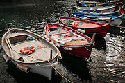 Photo of fishing boats in the harbor in Vernazza on the Cinque Terre, Italy