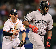 Aug 7, 2013; Houston, TX, USA; Houston Astros second baseman Jake Elmore (10) tags out Boston Red Sox designated hitter David Ortiz (34) in a run down during the third inning at Minute Maid Park. Mandatory Credit: Thomas Campbell-USA TODAY Sports