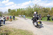 France, April 13th 2014: Followed by a TV motorbike, the break passes Pont Gibus, Wallers, during the 2014 Paris Roubaix cycle race.