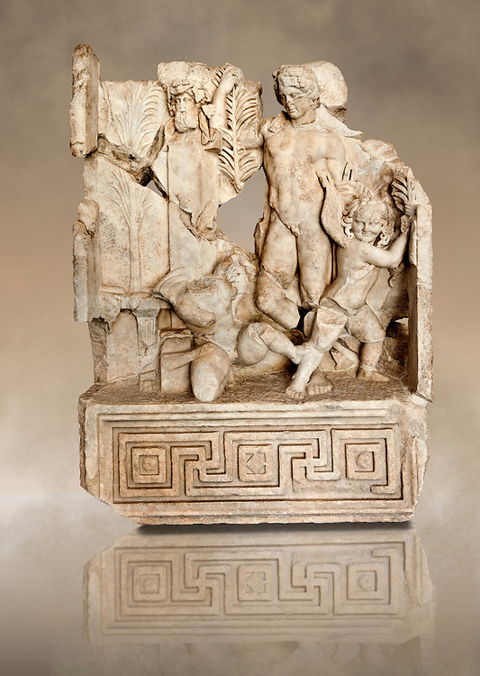 Photo of Roman releif sculpture, an allegory of an athletic contest [ Agon ]  Aphrodisias, Turkey, Images of Roman art bas releifs. Buy as stock or photo art prints. The pillar with a bearded head on it is Hermes the god of the gymnasium. Nearby is a palm of victiry with a ribbon on a prize table. Two winged baby Eros figures are stuggling over a palm branch acting out the idea of a contest. The youthful figure is Agon himself who holds a palm of victory