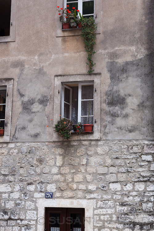 Windows with flower pots on the window sills in Montenegro.