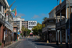 """A sign reads: """"Stay at home, if you can,"""" on Long Street in Cape Town, South Africa, Friday, April 10, 2020. The South African government has shut down the country, in response to Coronavirus, asking everyone but essential workers to stay home. PHOTO: EVA-LOTTA JANSSON<br /> [This is one is a series of landscapes shot in the Western Cape, South Africa, during the national lockdown in response to the Coronavirus.]"""