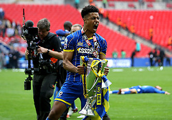 Goalscorer Lyle Taylor of AFC Wimbledon celebrates winning promotion to League One with the League Two Playoff Final trophy - Mandatory by-line: Robbie Stephenson/JMP - 30/05/2016 - FOOTBALL - Wembley Stadium - London, England - AFC Wimbledon v Plymouth Argyle - Sky Bet League Two Play-off Final