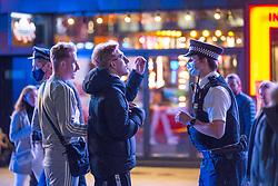 Licensed to London News Pictures. 10/10/2020. London, UK. Police patrol the street the revellers have been seen dancing at Leicester Square, central London. After the 10pm curfew early closing of pubs and bars. Photo credit: Marcin Nowak/LNP