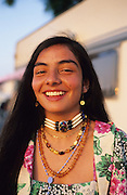 Beautiful Manouche girl wearing native Indian jewellery. Campsite at Saintes Maries de la Mer<br /><br />Europe, France, Camargue, Saintes Maries de la Mer. The Gypsies, pilgrims and participants of the festival at Saintes Maries. The Gypsy festuval attracts many well known characters, both visiting Gypsies and locals all dressed up for the occasion. Everyone loves to dress up and are proud of their traditions and culture.