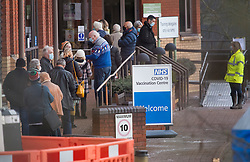 © Licensed to London News Pictures. 11/01/2021. Stevenage, UK. Members of the public queue to enter a COVID-19 vaccination hub at Robertson House at Hertfordshire Development Centre in Stevenage, Hertfordshire, which has opened for the first time today (Mon). Photo credit: Ben Cawthra/LNP