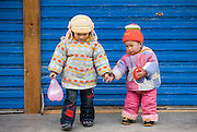 Zhuang Minority group girl being sisterly with boy in Ping An. China has a one child policy to limit population.