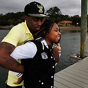 Rell Hamilton, 22, of Hilton Head Island, embraces his girlfriend Lexsy Johnson, 18, of Hilton Head Island, while enjoying some free time on the Alljoy Boat Landing dock on the May River in Bluffton on February 10, 2015.