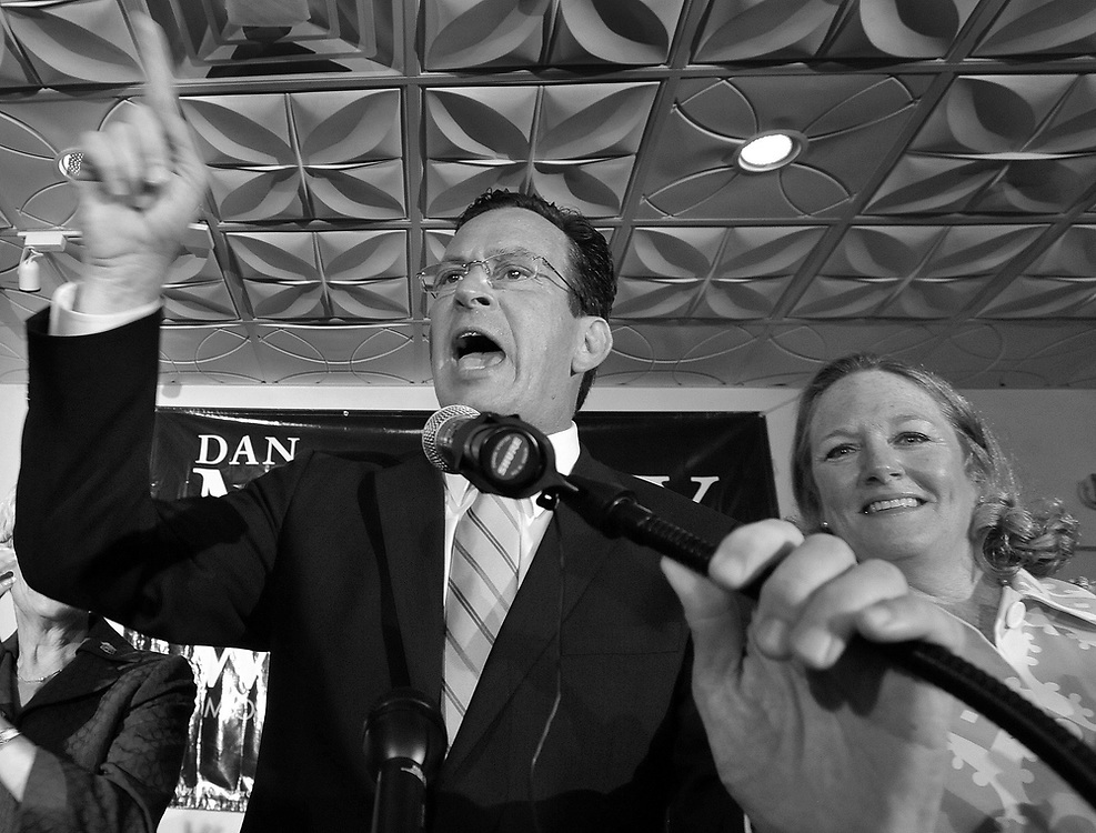 Democratic gubernatorial candidate Dan Malloy speaks to supporters while wife Cathy, right, looks on after defeating businessman Ned Lamont in the Democratic primary for Connecticut governor, in Hartford, Conn., on Tuesday, Aug. 10, 2010. (AP Photo/Jessica Hill)