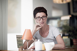 Mature woman drinking coffee in coffee shop, Freiburg im Breisgau, Baden-W¸rttemberg, Germany