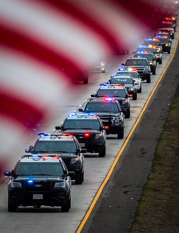 The procession for fallen Davis police officer Natalie Corona stretched down Highway 113 after the memorial on Jan. 18, 2019 in Davis, Calif. Corona was shot and killed on Jan. 10, 2019.