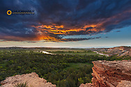 Dramatic sunset light in clouds over the Little Missouri River in the Little Missouri National Grasslands, North Dakota, USA