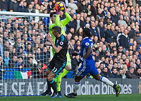 Football - 2016 / 2017 Premier League - Chelsea vs. West Bromwich Albion<br /> <br /> Thibaut Courtois of Chelsea comes out to catch above Gareth McAuley of West Bromwich Albion at Stamford Bridge.<br /> <br /> COLORSPORT/DANIEL BEARHAM