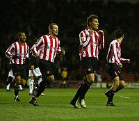 Photo. Andrew Unwin.<br /> Sunderland v Rotherham, Coca-Cola Championship, Stadium of Light, Sunderland 22/02/2005.<br /> Sunderland's Dean Whitehead (R of C) celebrates scoring his team's first goal.