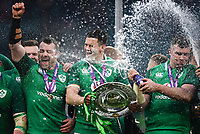LONDON, ENGLAND - MARCH 17: Ireland's Johnny Sexton, Peter O'Mahony and Cian Healy celebrate with the Triple Crown trophy after the NatWest Six Nations Championship match between England and Ireland at Twickenham Stadium on March 17, 2018 in London, England. (Photo by Ashley Western - MB Media via Getty Images)