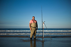 © Licensed to London News Pictures. <br /> 12/10/2014. <br /> <br /> Saltburn, United Kingdom<br /> <br /> Gary Hewitt from Eston pose for a picture during the annual Jim Maidens memorial beach fishing competition in Saltburn by the Sea in Cleveland. <br /> The competition is held each year to mark the death of Saltburn plumber and keen fisherman Jim Maidens who died in 1998 when he was killed after being swept overboard from his boat 'Corina' close to the beach at Saltburn.<br /> <br /> Photo credit : Ian Forsyth/LNP