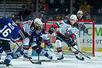 KELOWNA, BC - JANUARY 8: Tarun Fizer #18 passes the puck to Carson Miller #16 of the Victoria Royals to shoot on the net of Roman Basran #30 as Alex Swetlikoff #17 and Elias Carmichael #14 of the Kelowna Rockets check and attempt to block the shot during first period at Prospera Place on January 8, 2020 in Kelowna, Canada. (Photo by Marissa Baecker/Shoot the Breeze)
