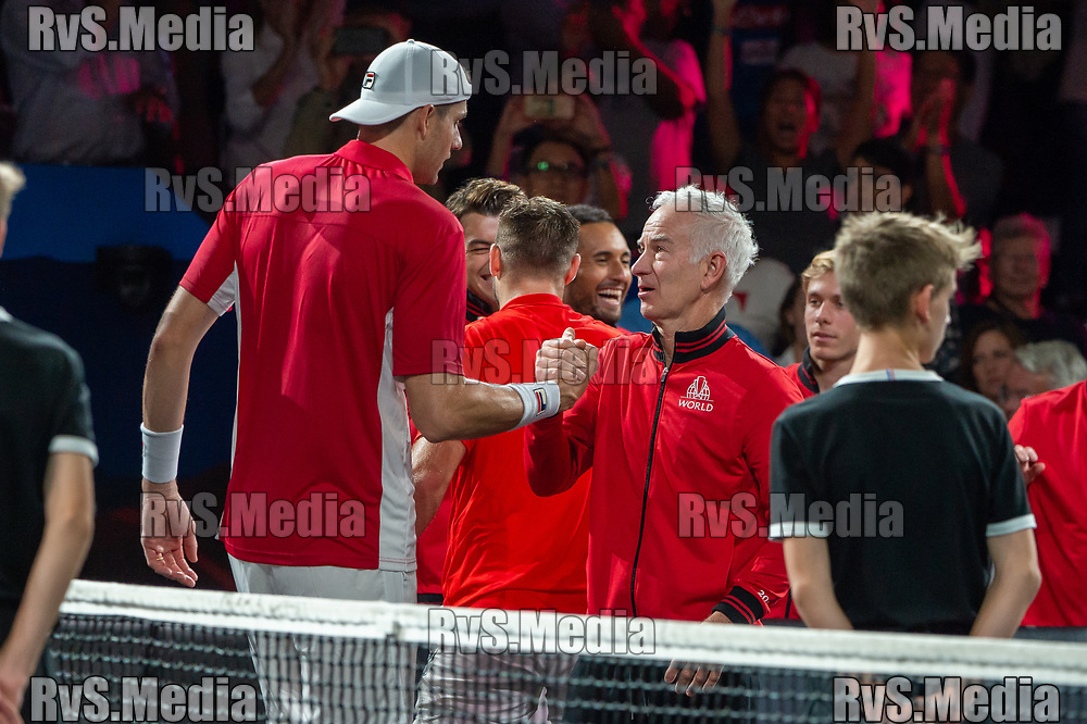 GENEVA, SWITZERLAND - SEPTEMBER 22: John McEnroe, Captain of Team World celebrates the win with John Isner during Day 3 of the Laver Cup 2019 at Palexpo on September 20, 2019 in Geneva, Switzerland. The Laver Cup will see six players from the rest of the World competing against their counterparts from Europe. Team World is captained by John McEnroe and Team Europe is captained by Bjorn Borg. The tournament runs from September 20-22. (Photo by Robert Hradil/RvS.Media)