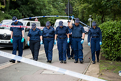 © Licensed to London News Pictures. 09/07/2020. London, UK. Members of a police specialist search team look for evidence near Seeley Drive in West Dulwich, South London where a man, believed to be aged 18, was found stabbed to death on Wednesday evening. Photo credit: Ben Cawthra/LNP