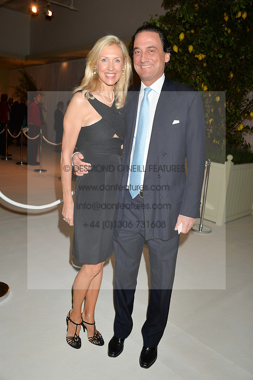 COUNT & COUNTESS ALESSANDRO GUERRINI-MARALDI at a dinner hosted by Cartier in celebration of The Chelsea Flower Show held at The Hurlingham Club, London on 19th May 2014.