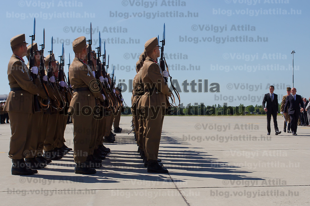 Anders Fogh Rasmussen (2nd R) secretary general of NATO and Csaba Hende (R) Defence minister of Hungary inspect the honour guard before they open a new hangar construction area of the Strategic Airlift Capability (SAC) programme in Papa (about 165 km west of Budapest), Hungary on July 01, 2013. ATTILA VOLGYI