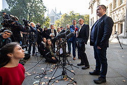 "© Licensed to London News Pictures. 10/10/2018. London, UK. Gareth Lee (right) speaks to media whilst leaving The Supreme Court after losing his case. Today the Supreme Court ruled that Daniel and Amy McArthur, owners of Ashers Bakery in Belfast, did not discriminate against Mr Lee by refusing to decorate a cake with the slogan ""Support Gay Marriage"". The case has become known as the 'gay cake' case. Photo credit : Tom Nicholson/LNP"