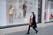 Shopping wearing a face mask in the upmarket area of Knightsbridge on 14th April 2021 in London, United Kingdom. Knightsbridge is one of the principal areas for exclusive, luxury goods in West London. It is known as a district where the rich and wealthy shop, mostly for high end fashion and jewellery.