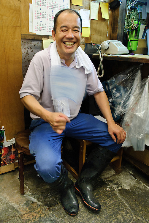 Portraits of people who work at Tsukiji fish market, Tokyo, Japan, April 22, 2007. The Tokyo Metropolitan Central Wholesale Market, better known as Tsukiji market, is the largest fish market in the world. Tsukiji is both a popular tourist attraction and a Mecca of Japanese food culture.