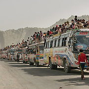 Pilgrims arriving after days in and on top of buses, coming mainly from the Thar desert region.