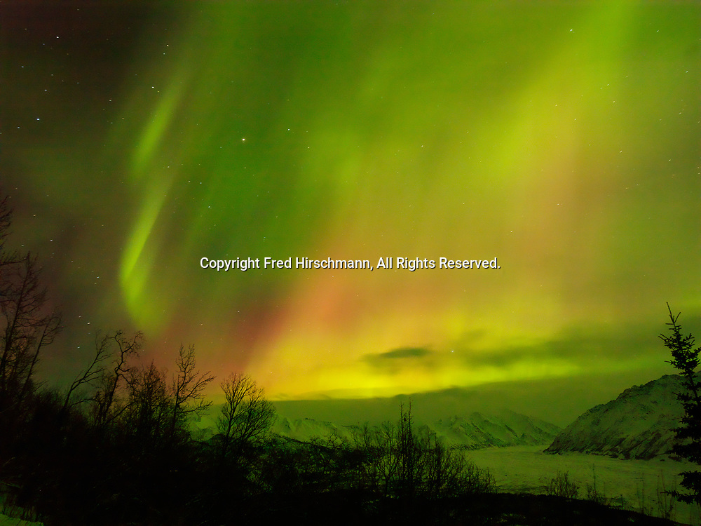 Green and red auroras over the Matanuska Glacier and Chugach Mountains during St. Patrick's Day Geomagnetic Storm, early morning hours of March 17, 2015, Glacier View, Alaska.