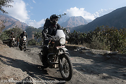 Sean Lichter with the Annapurna Range in the background on Day-7 of our Himalayan Heroes adventure riding from Tatopani to Pokhara, Nepal. Monday, November 12, 2018. Photography ©2018 Michael Lichter.