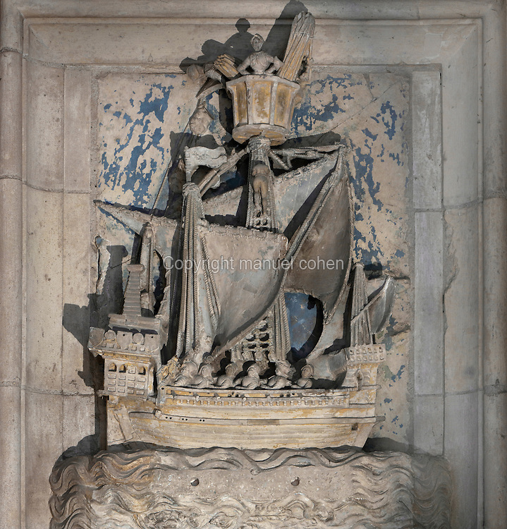 High relief of a French 15th century galley, from the Chambre des Galees, or Room of the Galleys, in the Palais Jacques Coeur, huge manor house built 1443-51 in Flamboyant Gothic style, on the Place Jacques Coeur, Bourges, France. This was the private bedroom of Jacques Coeur, within his private apartment, with decoration based on his fleet, originally furnished with a large bed, small bed, large wooden chest, sideboard, trestle table, bench and a tapestry of galleys bearing his motto. Jacques Coeur, 1395-1456, was a wealthy merchant and was made master of the mint to King Charles VII in 1438. Fulcanelli stated that Jacques Coeur was an alchemist and it is believed that the ships in this room may also be hermetic symbols, representing the ego and death. It may also refer to the Argonauts. The building is listed as a historic monument. Picture by Manuel Cohen
