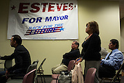 Mayor Jose Esteves supporters watch for election poll updates on a screen during the Mayor Jose Esteves party in Milpitas, California, on November 4, 2014. (Stan Olszewski/SOSKIphoto)