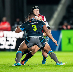 Tyler Bleyendaal of Munster  under pressure from Ma'afu Fia of Ospreys<br /> <br /> Photographer Simon King/Replay Images<br /> <br /> European Rugby Champions Cup Round 1 - Ospreys v Munster - Saturday 16th November 2019 - Liberty Stadium - Swansea<br /> <br /> World Copyright © Replay Images . All rights reserved. info@replayimages.co.uk - http://replayimages.co.uk
