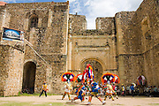 Dancers perform the Danza de la Pluma, or Dance of the Feather, a traditional Zapotec warrior dance, for the festival of Santiago Matamoros, the patron saint, in front of the monastery and church of Cuilapan, Oaxaca, Mexico on July 25, 2008.