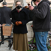 """Downing Street, London, UK. 2021-10-10. A funeral procession protest the UK government's continued refusal to break the big pharma monopolies endangering lives and prolonging the #COVID pandemic. The whole world is taking white medicine. """"Every year we see thousands of people die from diseases that the pharmaceutical industry don't invest in because they're"""