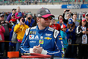 Dale Earnhardt Jr. waits for the start of the NASCAR Cup Series auto race at Kansas Speedway in Kansas City, Kan., Sunday, Oct. 22, 2017. (AP Photo/Colin E. Braley)