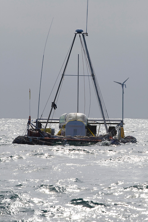 """On the second day of the voyage, the """"Junk"""" continues to be towed out to sea. On Sunday June 1, the raft named """"Junk""""  left Long Beach for it's 2100 mile voyage to Hawaii to bring attention to the plastic marine debris (nicknamed the plastic soup) accumulating in the North Pacific Gyre. The raft was designed and will be sailed by Dr. Marcus Eriksen of the Algalita Marine Research Foundation, and Joel Paschal, it is constructed from 15,000 plastic bottles, an airplane fuselage, discarded fishing nets and a solar generator. The raft was towed for two and a half days to near San Nicholas Island, about 65 mile of the coast of California, so it could catch favorable winds for it's trip. The tow boat was the ORV Alguita, captained by Charlie Moore of the Algalita Marine Research Foundation, the man credited for first discovering the plastic soup in the Gyre over 12 years ago."""