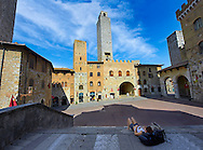 The Piazza Duomo (Cathedral Square) of San Gimignano with its medieval towers built as defensive towers and also to show the families wealth by the height of the tower. A UNESCO World Heritage Site. San Gimignano; Tuscany Italy .<br /> <br /> Visit our ITALY PHOTO COLLECTION for more   photos of Italy to download or buy as prints https://funkystock.photoshelter.com/gallery-collection/2b-Pictures-Images-of-Italy-Photos-of-Italian-Historic-Landmark-Sites/C0000qxA2zGFjd_k<br /> If you prefer to buy from our ALAMY PHOTO LIBRARY  Collection visit : https://www.alamy.com/portfolio/paul-williams-funkystock/sangimignano.html