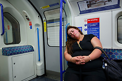 © Licensed to London News Pictures. 20/08/2016. London, UK. Tube passenger falls asleep whilst travelling on the night tube service of Victoria line in London for the first time on 20 August 2016. Transport for London started a 24-hour Tube service on Victoria and Central lines as demand has soared over recent years, with passenger numbers on Friday and Saturday nights up by around 70 per cent since 2000. The plan was announced in November 2013 and intended to begin in September 2015, but strikes over pay delayed the start by nearly another year. Photo credit: Tolga Akmen/LNP